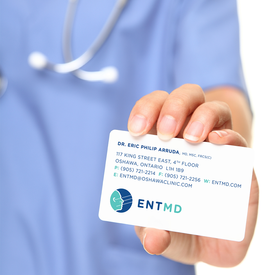 Doctor holding a business card
