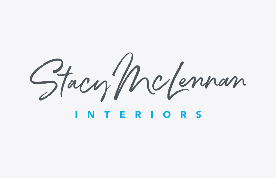Stacy McLennan Interiors logo on light background